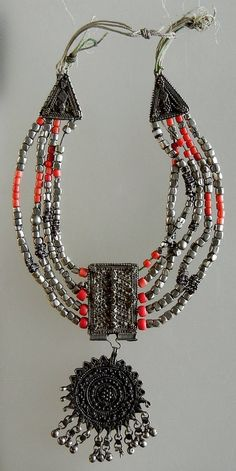 Yemen | Old silver and coral glass bead necklace that would need restringing.
