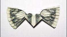 Money HEART with WINGS. It's an interesting tutorial. You need only 1 dollar bill. Only folding, no glue and tape. I recommend that you practice to fold this. Paper Origami Flowers, Paper Crafts Origami, Oragami, Origami Wedding, Origami Ball, Fun Origami, Origami Gifts, Origami Boxes, Origami With Money