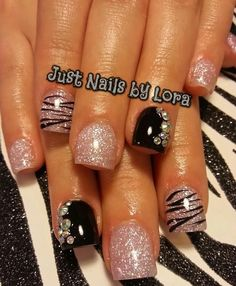 Acrylic nails by Lora @ Just Nails i love the sparkles and the rhinestone accent nail.