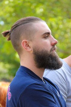 With the man bun Undercut, you grow the hair on the top of the head while keeping the sides and back of the head very short by buzzing it with a low hair clipper length. Description from menshairforum.com. I searched for this on bing.com/images