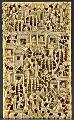 A Chinese carved ivory visiting card case, rectangular, profusely decorated with figures, trees and buildings