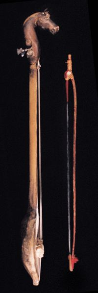 An igil is an ancient two-stringed Tuvan (South East Siberian) musical instrument. The strings, and those of the bow, are traditionally made of hair from a horse's tail.
