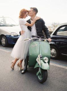 Philip kisses Rae durring wedding engagement photos on vintage vespa in Positano, Italy