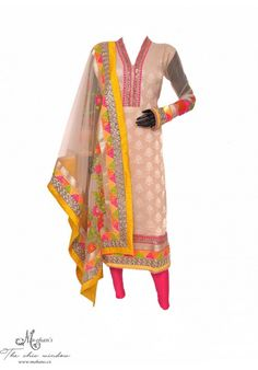 Elegant cream and hot pink  suit with floral work on dupatta