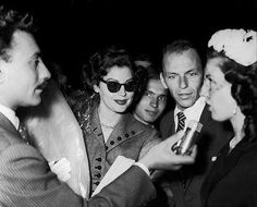 Ava and Frank mobbed at an airport, 1951