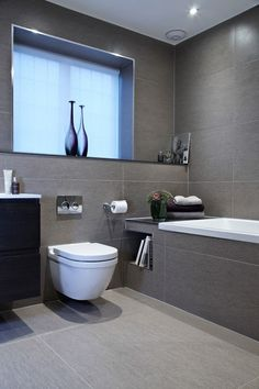 Bathroom Renovation Ideas: bathroom remodel cost, bathroom ideas for small bathrooms, small bathroom design ideas Bathroom Inspiration, Gray And White Bathroom, Bathroom Makeover, Grey Bathroom Tiles, Bathroom Interior Design, Gray Bathroom Decor, Small Bathroom Remodel, Modern Bathroom Design, Bathroom Layout