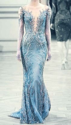 This dress reminds me of Elsa. I love how it looks like frost creeping up to her shoulders!