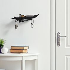 Heroshelf - The small stuff saver. This is a small, wall mount shelf, shaped like a superhero, used for hanging keys, placing glasses, smartphones, a wallet and all the other small belongings we carry in our pockets.