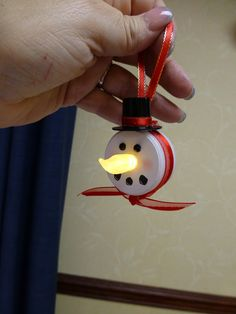 battery-operated tea light made into a snowman ornament. Easy kid craft from Dollar Tree products!