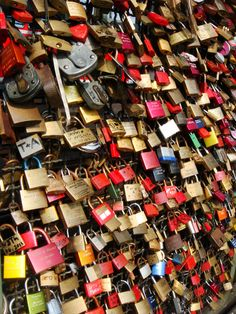 Engraved love locks on Hohenzollern Bridge in Cologne accompanied by keys that lovers throw into the water symbolizing their love for each other. <3