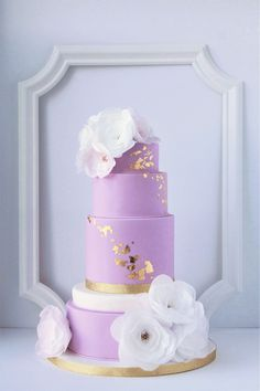 lavender wedding cake, gold leaf and wafer paper flowers #goldweddingcakes