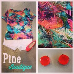 Neon splash top, S-L, $56.99. Paired with white cut off J Brand shorts, 25-27, $158.99. Bright coral Wanted flats, 5 1/2-9, $34.99. And neon Kate Spade earrings, $38.99! Shop with us through Facebook www.facebook.com/PineBoutique