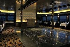 Terrazzo Lumina concrete tile floor on the Odyssey Cruise ship.  Edge lit with LEDs.