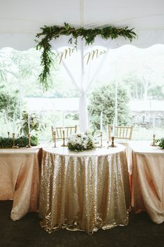 backyard wedding sweetheart table - photo by Kaytee Lauren http://ruffledblog.com/glam-handcrafted-virginia-wedding