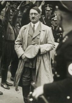 """Hitler in his """"ratty"""" 1934 trench coat. The widow of his architect, Gerdy Troost, so hated this coat that she purchased for him a new trench coat at the beginning of Hitler had previous ratty. Nazi Propaganda, German Soldiers Ww2, German Army, World History, World War Ii, Luftwaffe, The Third Reich, Battle Of Britain, Military History"""