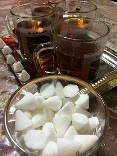 Persian tea and triangle sugar with cardamon flavor.