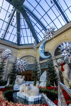 "Playful polar bears are featured in the 2018 winter display at Bellagio Conservatory & Botanical Garden. ""Majestic Holiday Magic"" is a can't-miss attraction for your winter in Las Vegas. Bellagio Conservatory, Polar Bears, See Photo, Botanical Gardens, Attraction, Las Vegas, Magic, Display, Mansions"
