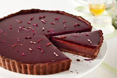 This gourmet chocolate ganache tart with beetroot, cherry and brandy jelly is a magnificent way to end a Christmas feast.