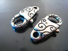 Finding - 2 pcs Silver Pattern Large Clasps 24mm x 13mm. $3.80, via Etsy.
