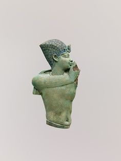 Inlay of the upper part of a king with arms raised Period: Late Period–Ptolemaic Period Date: 400–200 B.C. Geography: From Egypt, Memphite Region, Memphis (Mit Rahina) Medium: Faience, polychrome Dimen