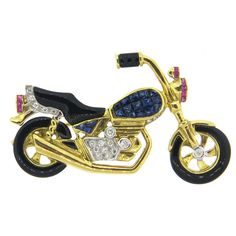 Onyx Sapphire Ruby Diamond Gold Motorcycle Brooch   From a unique collection of vintage brooches at https://www.1stdibs.com/jewelry/brooches/brooches/