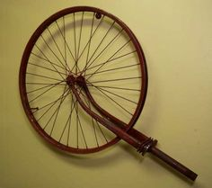 Vintage bike rim wall art-perfect by itself or use clothes pins to attach old family photos! By Lolly Molly Art