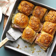 Caramelized Ham & Swiss Buns Recipe -My next-door neighbor shared her version of this recipe with me. You can make it ahead and cook it quickly when company arrives. The combo of poppy seeds, ham and cheese, horseradish and brown sugar makes it simply delicious!—Iris Weihemuller, Baxter, Minnesota