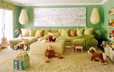 What a cozy room to play and nurture the kidlets in. {we have that bike, stick horse and activity cube - LOL!}