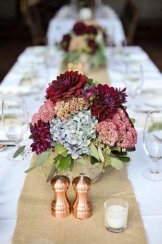 centerpieces of elegant blue hydrangea and burgundy dahlias