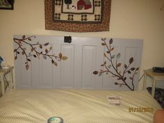 My new headboard made from old door painted gray and a decal applied.