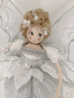 A beautiful Christmas tree fairy entirely handmade in Yorkshire by the fairy maker. She is resplendent in a fairytale white gown of