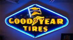 1952 Goodyear Tires single-side neon porcelain dealership sign with flag logo. - Barrett-Jackson Auction Company - World's Greatest Collector Car Auctions