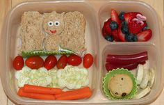 A Princess cut from a half-sandwich using Lunch Punch Sand-wishes cutters (sugar eyes and food pen drawn mouth), baby grape tomatoes, cucumber flowers, carrots, strawberries and blueberries, a couple of mini chocolate chip cookies, some freeze-dried bananas, and some Australian-cut licorice.    http://easylunchboxes.smugmug.com/The-Best-Lunchbox-System/Yummy-Lunch-Ideas/10136835_SnmBV2#!i=1018903463&k=NSk44