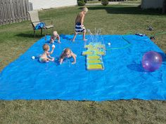 Put a tarp out, put the sprinkler on top of it and presto, a large area for everyone to jump, run and splash around in. The water stayed on the tarp so it eventually became a slip n slide for them too. Add a few plastic balls.