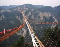Glass Suspension Bridge Under Construction In Zhangjiajie [ChinaFotoPress via Getty Images] Zhangjiajie, Bridge Construction, Under Construction, Bridges Architecture, Grand Canyon, Scary Bridges, Glass Bridge, Rope Bridge, Dangerous Roads