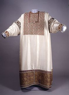 Another ceremonial suit of the Norman kings of Sicily - The Alba (from albus ie. white) of King William of Sicily (ca.1181 CE). The embroideries on silk, with precious stones that garnish the chest, the flap of the tunic and the borders of the sleeves were probably added to the time of Emperor Frederick II.