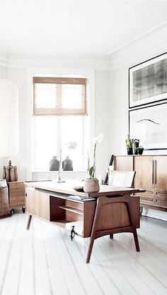 Midcentury Modern. If we started off by painting everything white this shows that your desks (and chairs) would look good. You could then go for a dark or light floor with painted boards or a floor covering and introduce colour to the walls with property displays in individual photo frames.