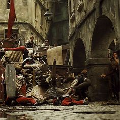 Gavroche and Courfeyrac in Les Misérables (gif) <--- LOOK AT ENJORLAS TRY TO HELP - FEELS!!!!