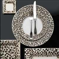 Leopard Patterned Dishes, this would be amazing in my fantasy of a dream, lime green funky fresh kitchen!