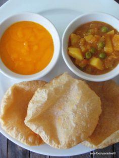 Mango creamed puree, Peas potato curry. and deep fried wheat Puris.... Traditional Maharashtrian meal for summer!