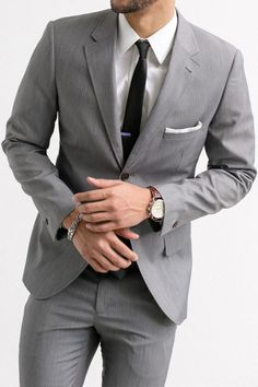 Grey suit paired with classic white shirt.