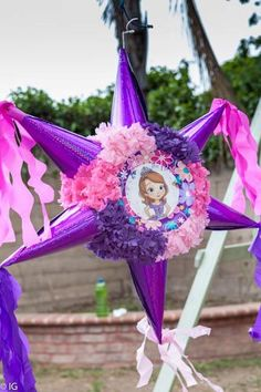 """Pinata bought from a local store, then pasted a picture of Sofia the First. Kids were given a """"Troll's club"""" for hitting the pinata."""