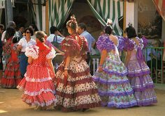 Women of Sevillanas with their traditional dress used in a popular flamenco dance