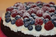 Chocolate torte with raspberry and blueberry