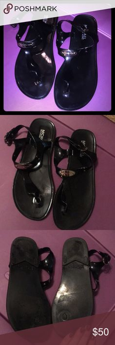 Michael Kors Black Jelly Sandals Worn a few times.   Authentic MICHAEL Michael Kors Jelly Sandals in Black! Silver toned emblems.   Have been sitting in my closet for the past year. Great condition!  Size 8. MICHAEL Michael Kors Shoes Sandals