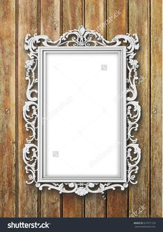 #Silver #Baroque #blank #picture #frame on #brown #wooden #boards #background