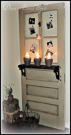 Down to Earth Style: Old Door Foyer Display - could use paned window on top of my fireplace mantle decorated like this!
