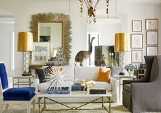 melanie turner eclectic glam living room--white walls, brass accents, cobalt velvet carved chair