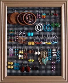 DIY Earring Board    All you need is a picture frame and some wire.