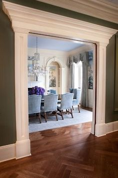 Stunning traditional dining room through a heavily framed double wide archway by Thomas Burak. Love how the green of the hall perfectly enhances the mural in the predominantly blue dining room. Don't forget about the lovely hydrangeas, velvet chairs,. Home Improvement Projects, Home Projects, Moldings And Trim, Moulding, Crown Moldings, Door Molding, Archway Molding, Molding Ideas, Crown Molding Shelf
